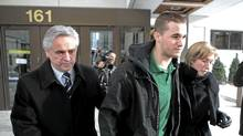 Former Premier of Newfoundland Brian Tobin, (left) and wife Jodean Tobin (right) escort their son Jack Tobin (centre) out of Ottawa court following his release on bond for $100,000 for being charged in the death of a man in a Christmas Eve accident in Ottawa on Saturday, December 25, 2010. (Pawel Dwulit/The Canadian Press/Pawel Dwulit/The Canadian Press)