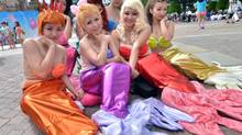 Disney is not just about Orlando, Fla.: Some fanatics visit Disney theme parks around the world, such as this one in Tokyo, where visitors dressed in costumes of Princess Ariel. (YOSHIKAZU TSUNO/AFP/Getty Images/Newscom)