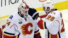 Calgary Flames Robyn Regehr (R) congratulates Miikka Kiprusoff (L) after beating the Colorado Avalanche in their NHL hockey game in Denver, Colorado April 2, 2010. REUTERS/Mark Leffingwell (MARK LEFFINGWELL)