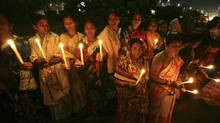 Indian women hold candles as they participate in a silent protest rally in the eastern Indian city Bhubaneswar, India, Dec. 20, 2012. (Biswaranjan Rout/AP)