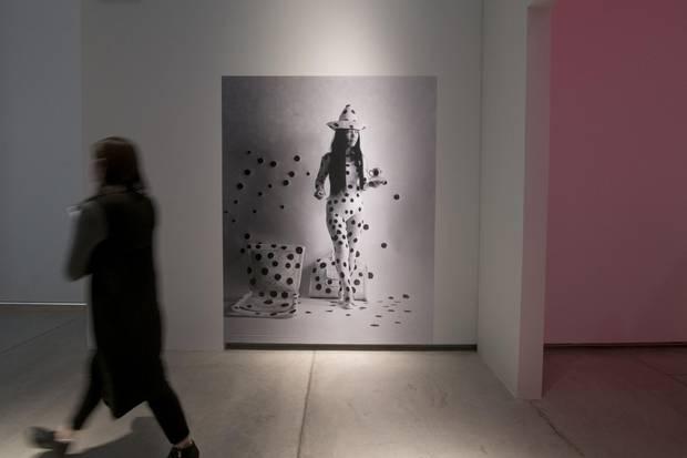 A portrait of the artist Yayoi Kusama.