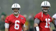 New York Jets quarterbacks Mark Sanchez, left, and Tim Tebow look on during NFL football practice, Thursday, May 24, 2012, in Florham Park, N.J. (Julio Cortez/AP/Julio Cortez/AP)