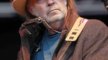 Neil Young performs at a benefit concert in Mountain View, Calif., on Oct. 24, 2010. (TONY AVELAR/ASSOCIATED PRESS)