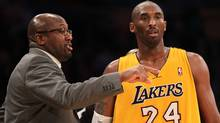 Kobe Bryant of the Los Angeles Lakers confers with head coach Mike Brown during the game against the Utah Jazz at Staples Center. (Stephen Dunn/2011 Getty Images)