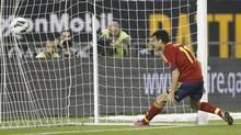 Spain's Pedro Rodriguez scores against Uruguay during their international friendly soccer match in Doha February 6, 2013. (MOHAMMED DABBOUS/REUTERS)