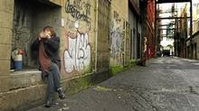 A aboriginal prostitute smokes some crack in Vancouver's lower East side February 8, 2002. Police are investigating the house and surrounding farm as part of their investigation into the disappearance of up to 50 woman. (John Lehmann/Globe and Mail/John Lehmann/Globe and Mail)