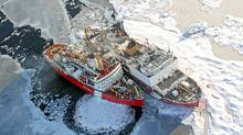 A helicopter view of the Canadian Coast Guard ship Louis S. St. Laurent, left, and the U.S. Coast Guard Cutter Healy on the Arctic Ocean. (Jessica K. Robertson /U.S. Geological Survey/Jessica K. Robertson /U.S. Geological Survey)