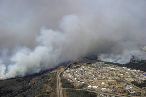 A Canadian Joint Operations Command aerial photo shows wildfires near neighborhoods in Fort McMurray Wednesday posted on social media.