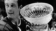 Montreal Canadiens team captain Jean Beliveau holds the coveted Stanley Cup in Chicago Tuesday, May 19, 1971, following the Canadiens 3-2 victory over the Chicago Blackhawks. (The Canadian Press)