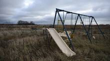 A swing set and slide sit unused on an abandoned home on the Lake St. Martin reserve in Manitoba on Oct 31, 2012. (Fred Lum/The Globe and Mail)
