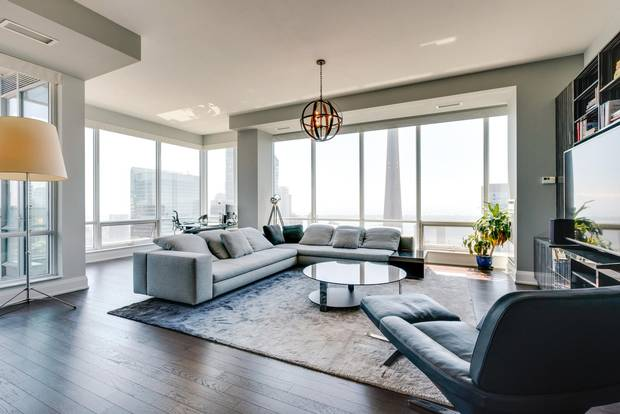 The central living space of Penthouse 4 at 80 John St.