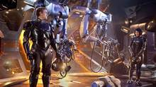 Pacific Rim is an upcoming 2013 American science fiction film directed by Guillermo del Toro and written by del Toro and Travis Beacham. The film is set in the near future where soldiers pilot giant mecha into battle against invading giant monsters who have risen from a portal beneath the ocean. (Handout)