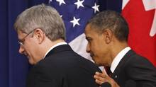 U.S. President Barack Obama (R) and Canadian Prime Minister Stephen Harper leave after a news conference in the Eisenhower Executive Office Building in Washington February 4, 2011. (LARRY DOWNING/REUTERS)
