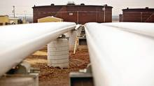 Oil pipelines run near storage tanks at the Enbridge Inc. Cushing Terminal in Cushing, Okla. (Shane Bevel/Shane Bevel/Bloomberg News)