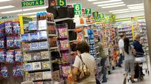 People shop in a Dollarama store in Montreal. (Christinne Muschi/Christinne Muschi/THE GLOBE AND)