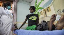 This is a Thursday, Feb. 27, 2014 file photo of a newly-diagnosed HIV positive woman, who arrived at the hospital with symptoms of tuberculosis (TB), receives treatment at the Mildmay Uganda clinic in Kampala, Uganda . (Rebecca Vassie/AP)