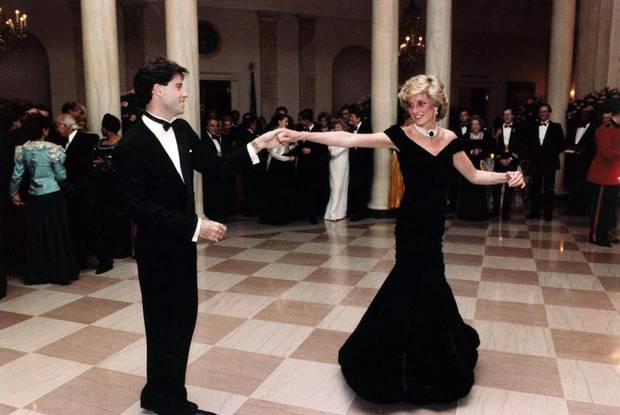 In this Nov. 9, 1995 photo provided by the Ronald Reagan Library, actor John Travolta dances with Princess Diana at a White House dinner. (AP Photo/Ronald Reagan Library)