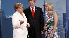 Germany's Chancellor Angela Merkel (L) is greeted by Canada's Prime Minister Stephen Harper and his wife Laureen as she arrives at the G20 Summit in Toronto, June 26, 2010. (Jim Young/Reuters)