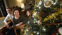 Christina de Jong and her children Simon, 18, and Ella, 14, will be spending Christmas away from her Scarborough, Ont., home this year. (FRED LUM/The Globe and Mail)