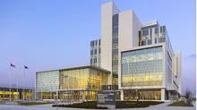 The Durham Consolidated Courhouse sits on a six-acre site acquired from General Motors and remediated at the city's expense. Its clean, bright look has brought two awards - for brownfield redevelopment and green building. (Shai Gil Fotography)