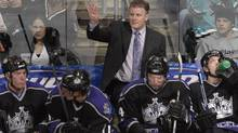 Marc Crawford, seen behind the Los Angeles Kings' bench during the 2006-07 season, is the new coach of the Dallas Stars. (Juan Ocampo/2007 Getty Images)