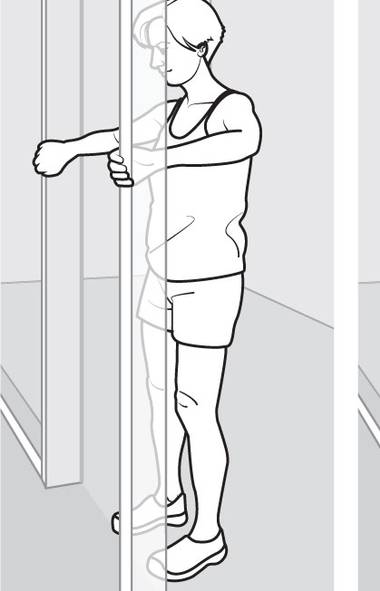 Grip the sides of a door frame with both hands at chest height. (Murat Yukselir/The Globe and Mail)