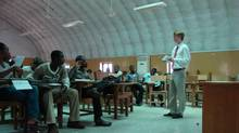 A student at the University of Western Ontario's Richard Ivey School of Business teaches students in Ghana. (Richard Ivey School of Business)