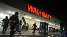Shoppers wheel their purchases out of a Wal-Mart store in Los Angeles, Calif. (ROBYN BECK/AFP/Getty Images)