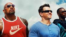 Dwayne Johnson and Mark Wahlberg in Pain & Gain: 'This role is a risky move for Dwayne,' Wahlberg says. 'He's usually got this wholesome, heroic thing going on.' (uncredited/AP)