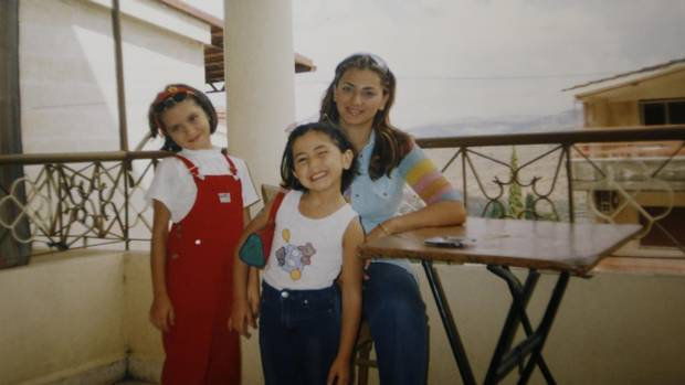 Nancy Solakian, a Syrian refugee who immigrated to Canada in search of a better life, with her mom Ani and sister Mery, left.