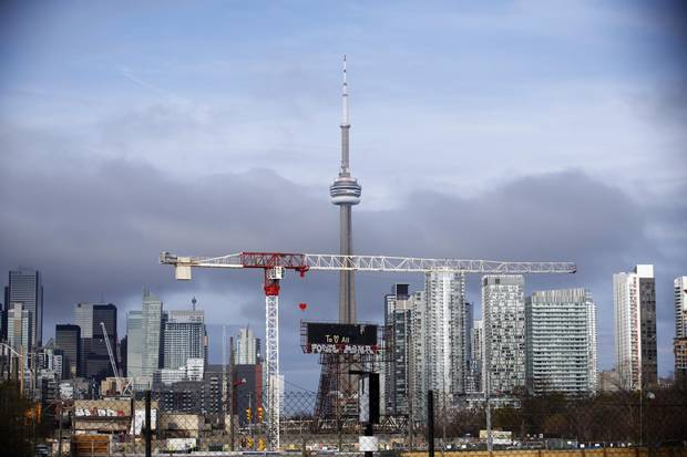 Toronto's CN Tower. The city's rising home prices and terrible traffic could detract from th region's bid.