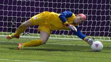 Canada goalkeeper Erin McLeod makes a diving save against France during second half women's bronze medal football action at the 2012 Olympic Games in Coventry, England, on Thursday, August 9, 2012. (Frank Gunn/THE CANADIAN PRESS)
