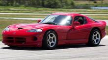 Andres Diaz races the 1997 Dodge Viper he bought new at MotorSport Ranch in Cresson, TX earlier this year. (Ross Hailey for The Globe and Mail)