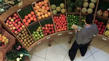 A customer looks at fruit in a store in central London April 12, 2011. (STEFAN WERMUTH/REUTERS)
