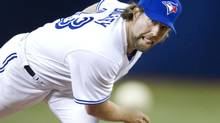 R.A Dickey has a 3.95 ERA in starts when the Rogers Centre's roof is closed. (FRED THORNHILL/THE CANADIAN PRESS)