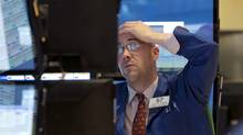 During the flash crash of May 6, 2010, investors who had placed stop-loss orders saw their stocks sell for far less than their trigger prices. (Richard Drew/AP)
