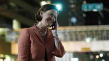 PC Alberta leader Alison Redford talks on the phone while walking back to her hotel after she won the provincial election in Calgary, Alberta, April 23, 2012. Redford and the PC party defeated the Wildrose party to continue their 40 year legacy of holding power in Alberta. (Todd Korol/Reuters)