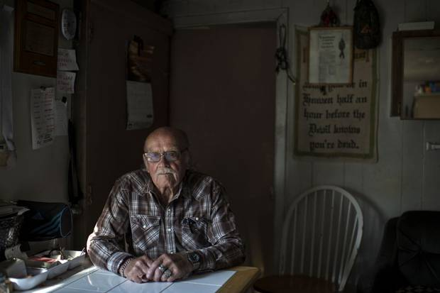 Jackie Vautour, 88, sits in the shack where he lives in the middle of New Brunswick's Kouchibouguac National Park. The province expropriated the land in the 1970s, but while all other ex-residents of the park land have moved on, he has not.