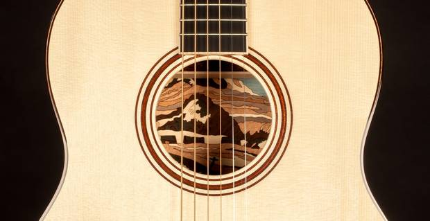 Jean Larrivée says he wanted his guitar to showcase the artist it was inspired by – in this case, A.Y. Jackson – so he created a 200-piece mosaic recreating a Jackson painting inside the instrument's body.