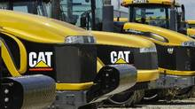 Caterpillar earth moving tractors and equipment in Clinton, Ill. (Seth Perlman/AP Photo)