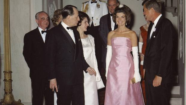 John F. Kennedy and Jackie Kennedy attend a dinner in Washington on May 11, 1962.