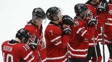 Canada's Charles Hudon (10), Frederik Gauthier (22), Josh Morrissey (7) and Nic Petan react after their loss to Finland in their IIHF World Junior Championship ice hockey game in Malmo, Sweden, January 4, 2014. (Alexander Demianchuk/REUTERS)