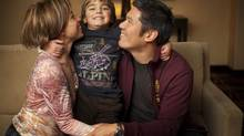 Jennifer Damiano and Bert Lee, with their son, Ruslan Lee, who was adopted from Kazakhstan. The family is trying to adopt a child from Russia. (DENNIS DRENNER FOR THE GLOBE AND MAIL)