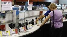 U.S. consumer spending picked up in January-February, the Fed's Beige Book shows. (KEVIN LAMARQUE/REUTERS)