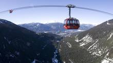 Even non-skiers can enjoy the views from Whistler's Peak 2 Peak gondola, seen here as it crosses its highest point: 435 metres over Fitzsimmons Creek. (Jonathan Hayward/THE CANADIAN PRESS)