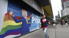 A large billboard faces onto a King Street West branch of the Royal Bank of Canada on Wednesday. With Worldpride 2014 in Toronto and the Pride parade coming up this weekend, two of the major banks have put up advertisements that prominently include the LGBT community. A billboard for the TD Bank and a storefront ad for the Royal Bank of Canada are photographed on June 25 2014. (Fred Lum/The Globe and Mail)