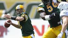 Edmonton Eskimos' quarterback Mike Reilly (L) rears to throw against the Saskatchewan Roughriders during their CFL football game in Edmonton June 29, 2013. (DAN RIEDLHUBER/REUTERS)
