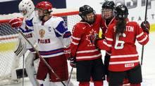 Team Canada's Hayley Wickenheiser celebrates with teammates Jocelyne Larocque and Rebecca Johnston. (Ryan Remiorz/The Canadian Press/Ryan Remiorz/The Canadian Press)