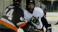 In this file photo a Minor Midget AAA players prepares to hit his opponent. (RANDY QUAN/The Globe and Mail)