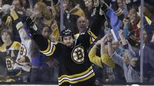 Boston Bruins defenseman Adam McQuaid celebrates his goal against the Pittsburgh Penguins during the third period of Game 4 in the Eastern Conference finals of the NHL hockey Stanley Cup playoffs, in Boston on Friday, June 7, 2013. (Associated Press)